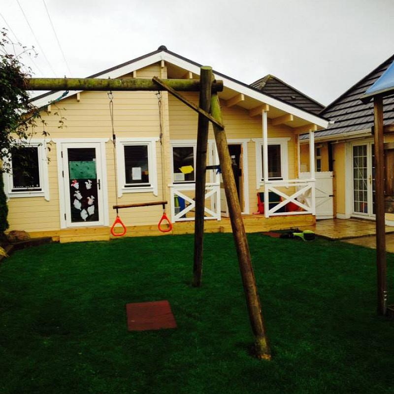 Beehive Pre-School Log Cabin Front