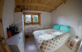 One Bed Log Cabin Bedroom