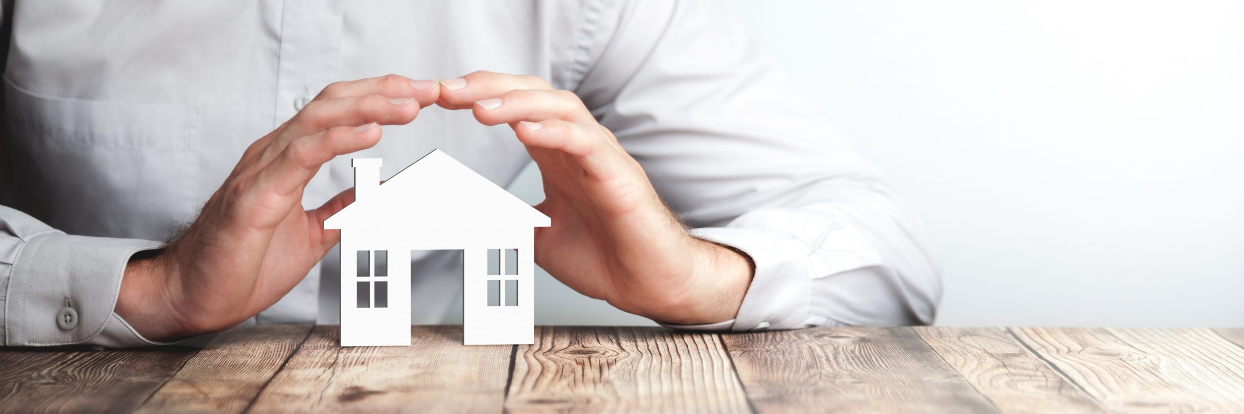 Protecting Hands Over House - Home Security And Protection Concept