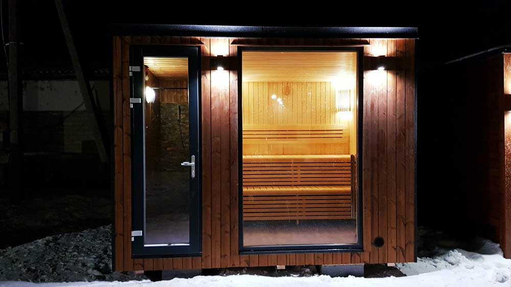 Loghouse's-new-sauna-garden-room---Exterior-at-night